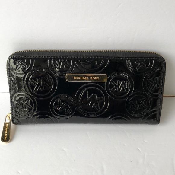 59383ecb53b8 MICHAEL Michael Kors Black Patent Wallet. M_5ab30e323800c5992469e5b7